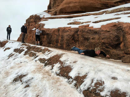 Sliding at Arches National Park