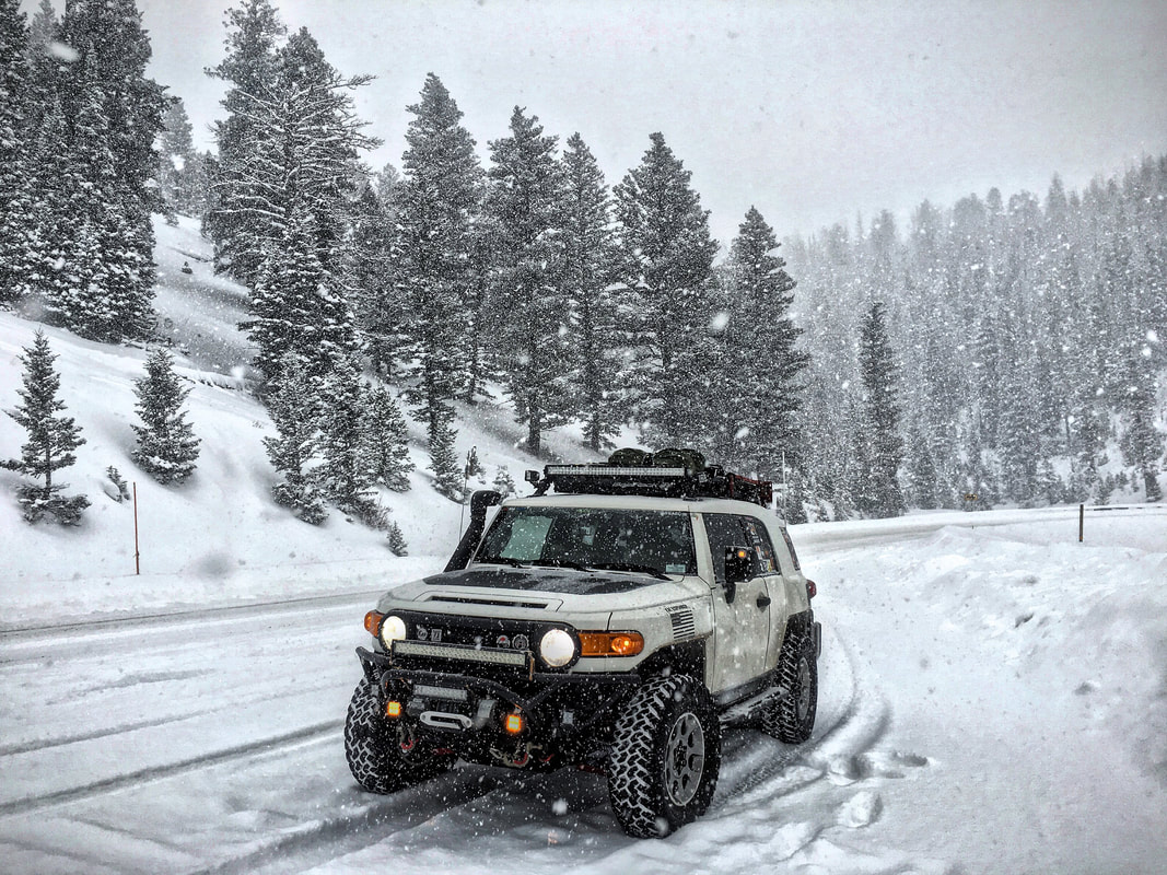 FJ Cruiser driving in snow up in the mountains